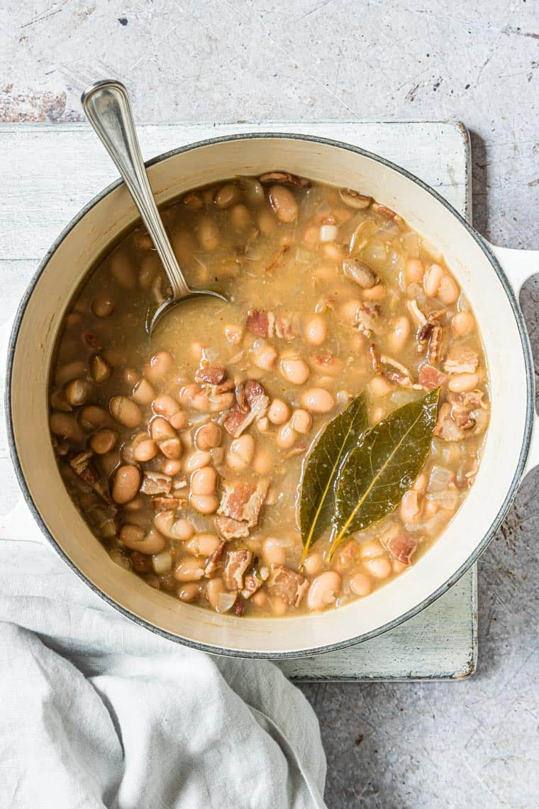 pinto beans in a pot with serving spoon inside