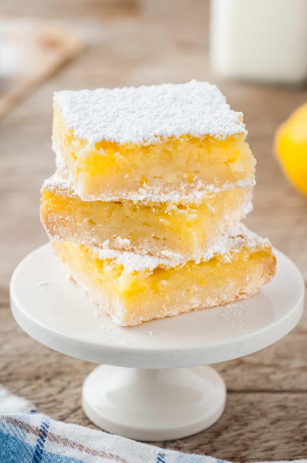 three lemon bars dusted with powdered sugar