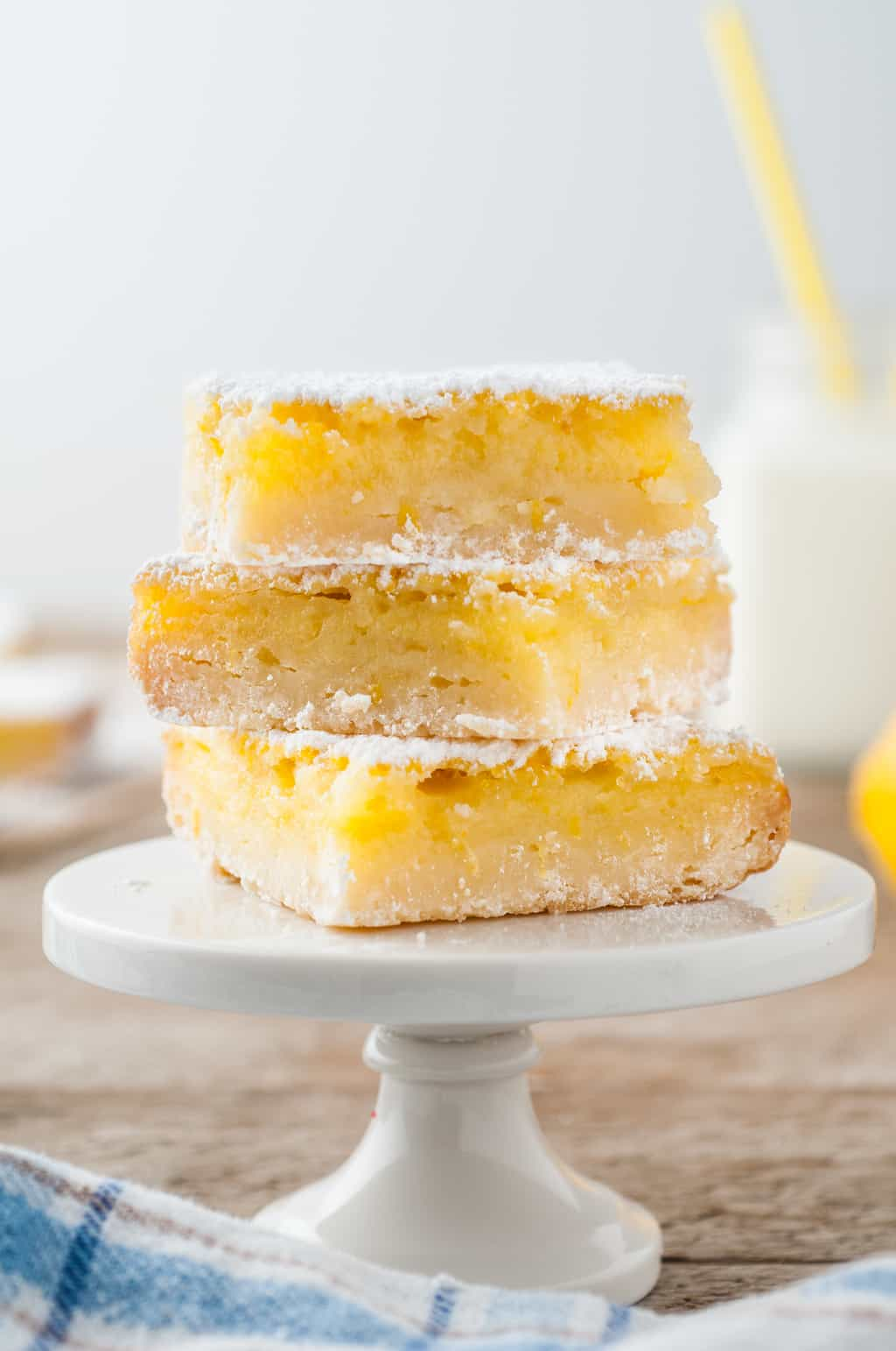 side view of three stacked lemon bars
