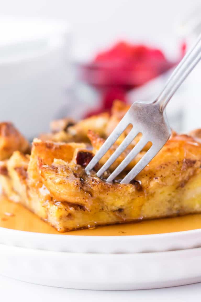 Close up of fork dipping into baked french toast casserole