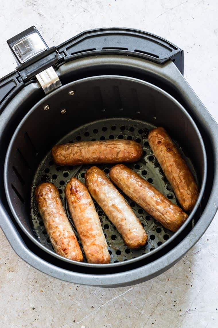 cooked sausages inside the air fryer