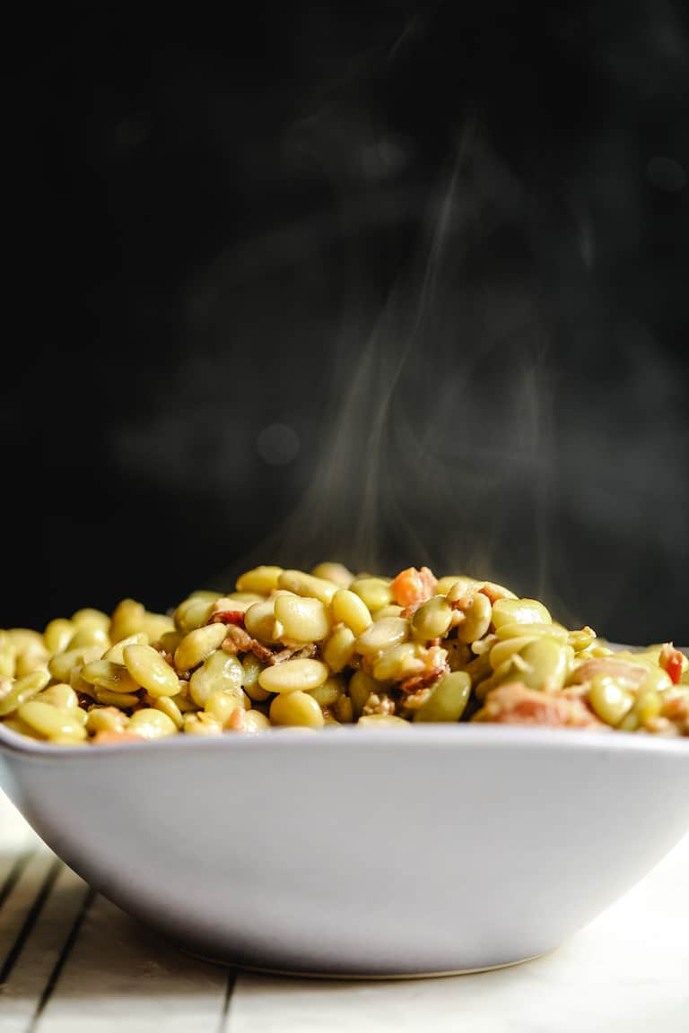 side view of a serving dish filled with butter beans