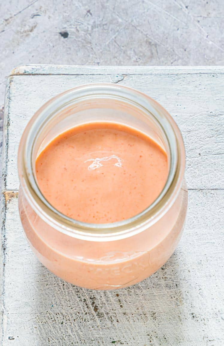 a glass jar containing the finished remoulade sauce recipe