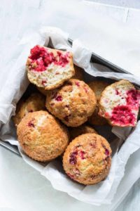 air fryer raspberry muffins in a container