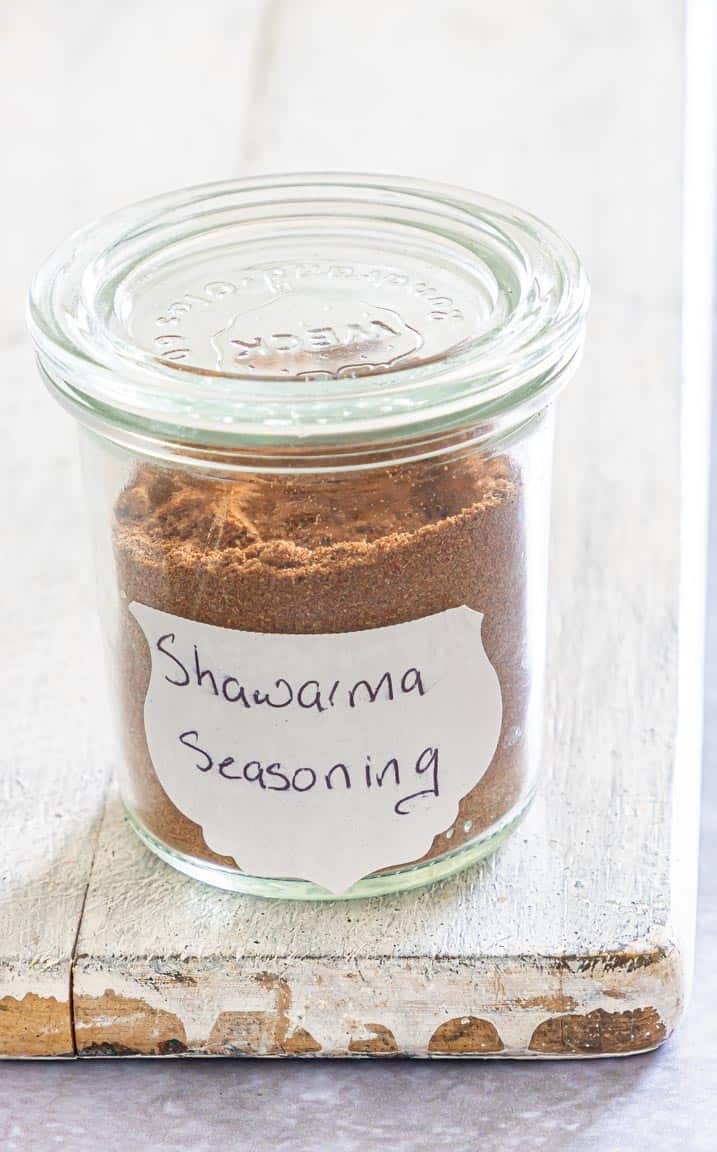 shawarma seasoning packaged in a glass container with handwritten label