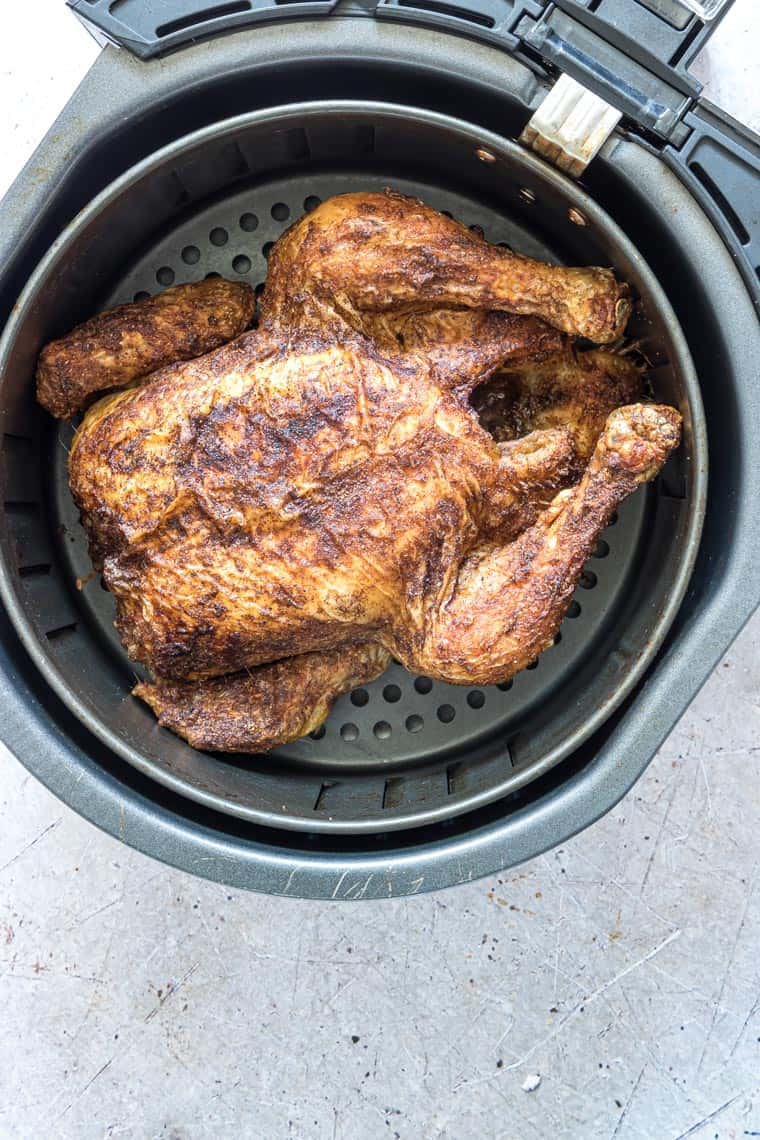top down view of air fryer cornish hen inside the air fryer basket
