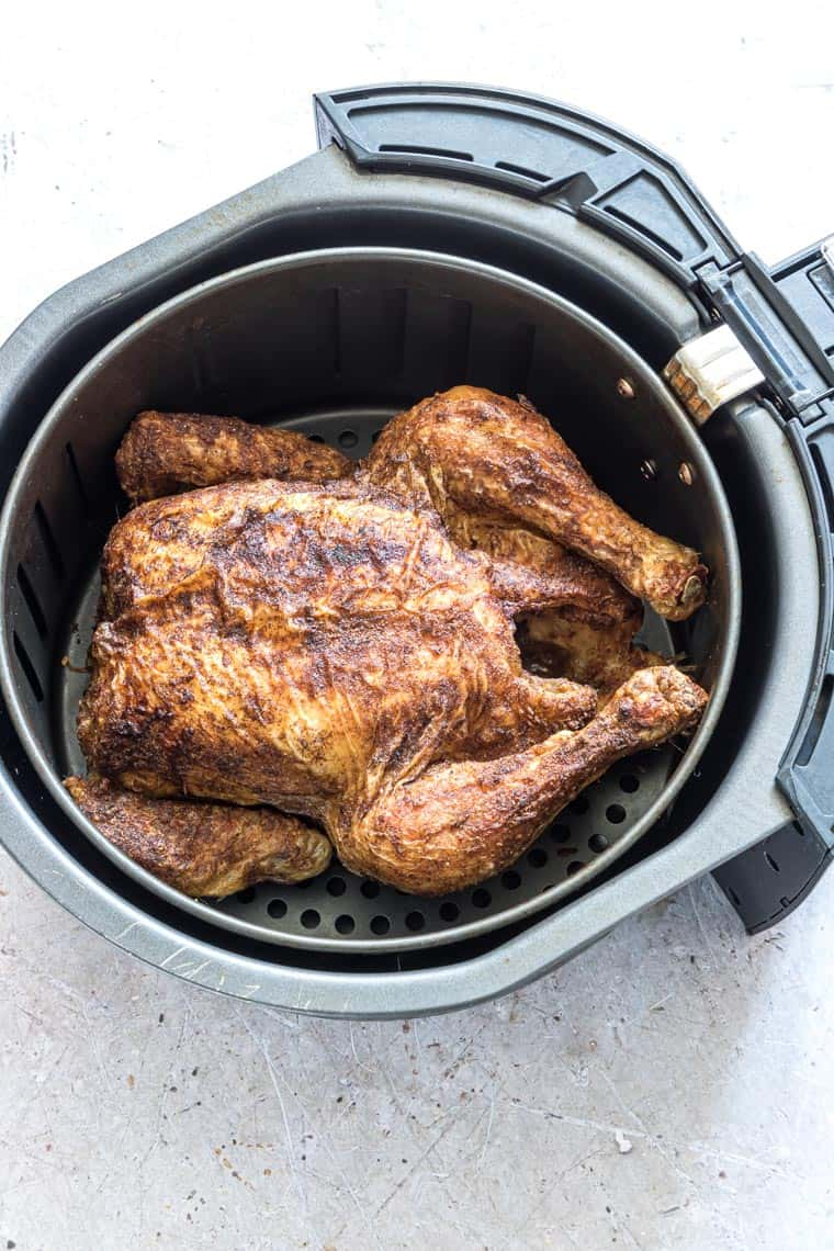 cornish hen inside the air fryer and ready to serve