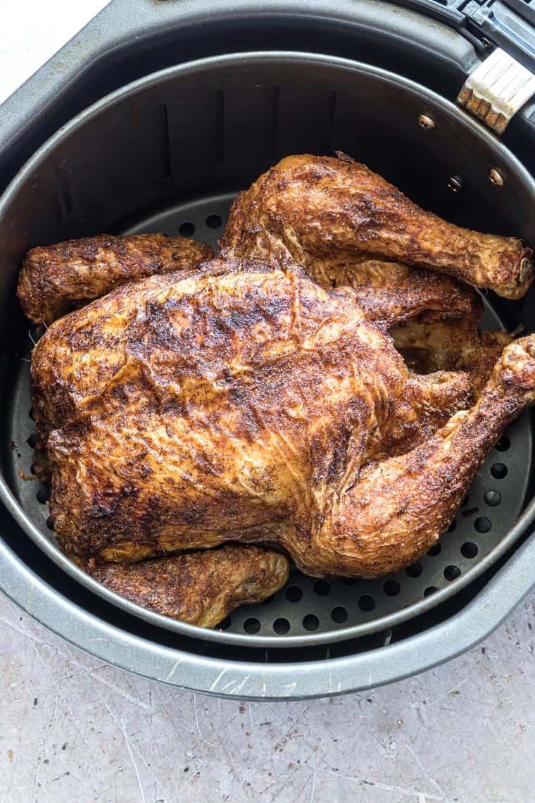 finished air fryer cornish hen inside the air fryer basket