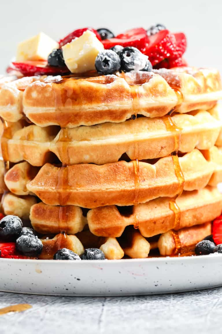 side view of a stack of buttermilk waffles