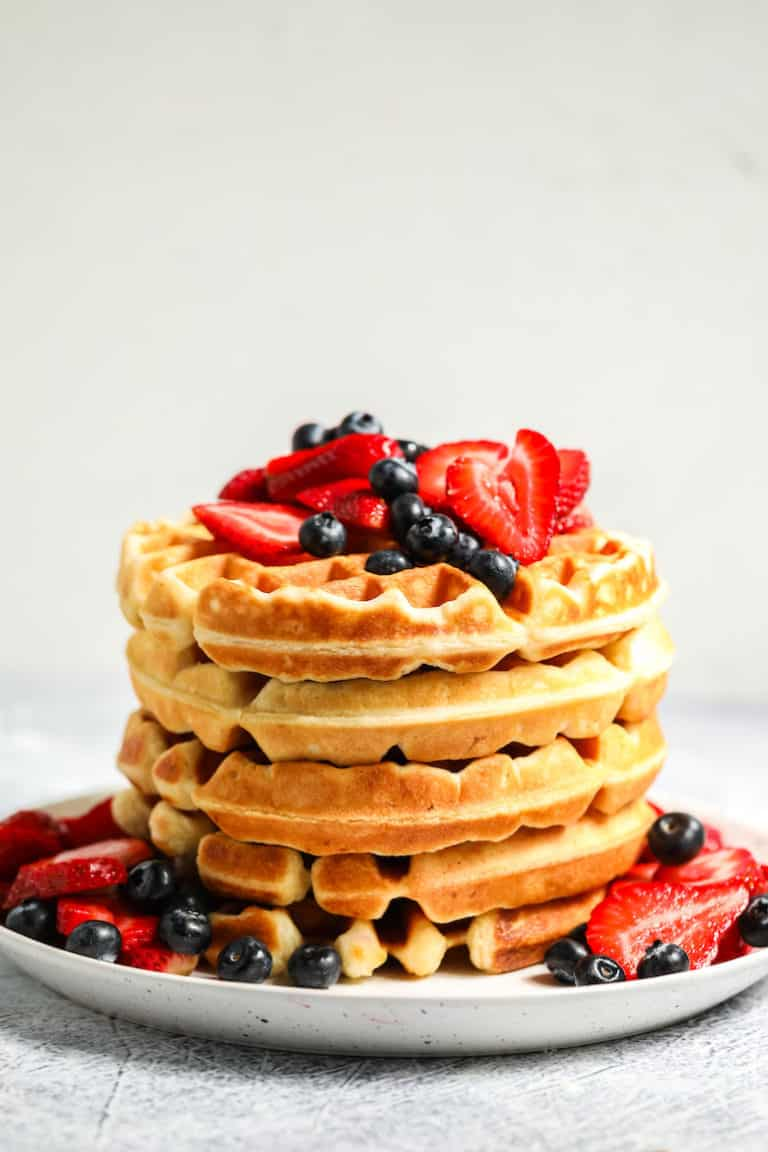 side view of stacked buttermilk waffles