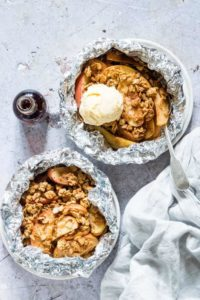 2 bowls of campfire apple crisp foil packets with ice cream