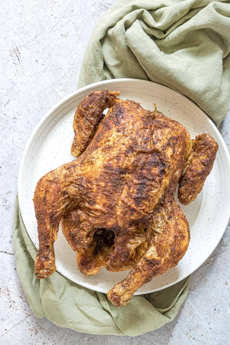 the completed instant pot cornish hen on a white plate