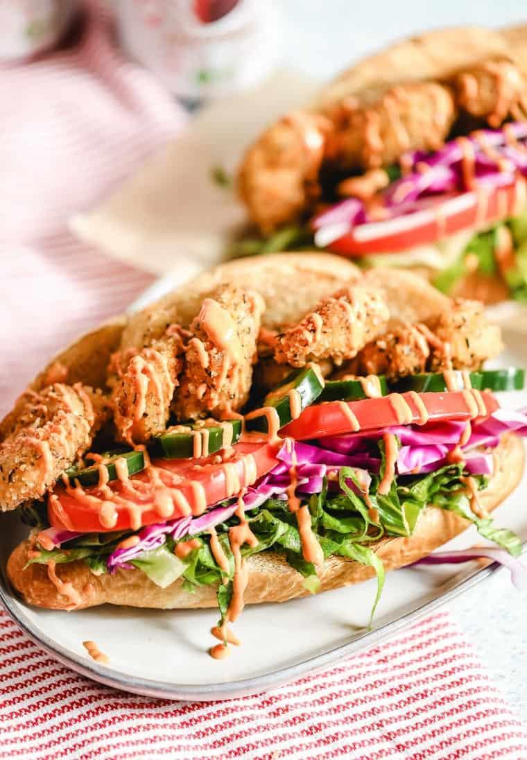 two shrimp po boy sandwiches