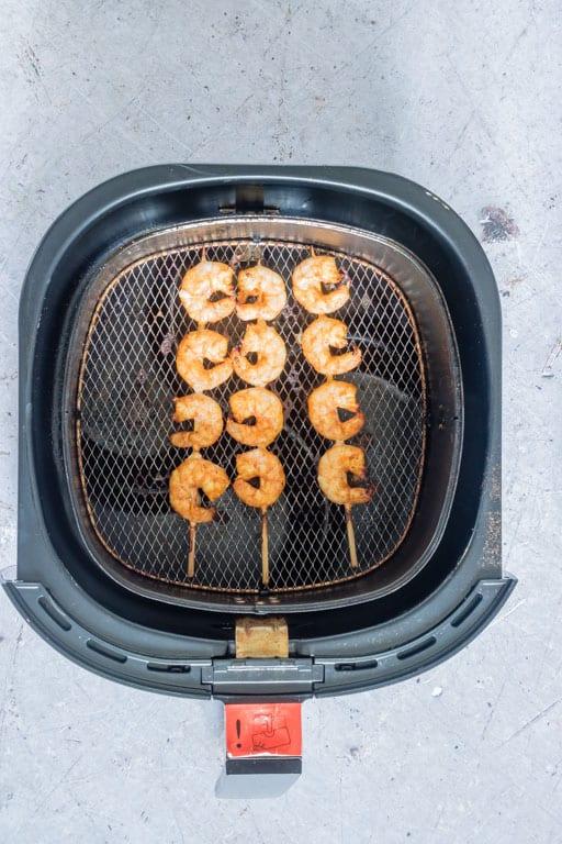 grilled shrimp skewers inside the air fryer basket