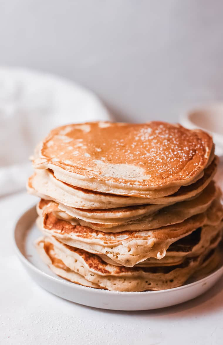 a stack of cooked buttermilk pancakes