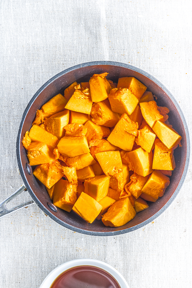 a saucepan filled with cubed pumpkin about to be made into pumpkin puree