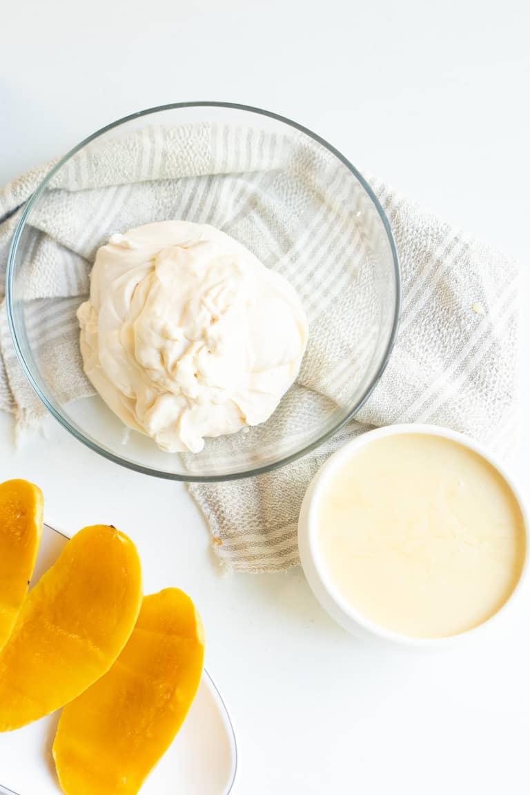 the ingredients needed to make mango ice cream