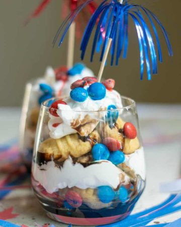 red white and blue trifle served in glass jars