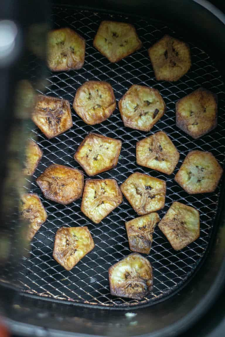 air fryer banana chips inside the air fryer basket