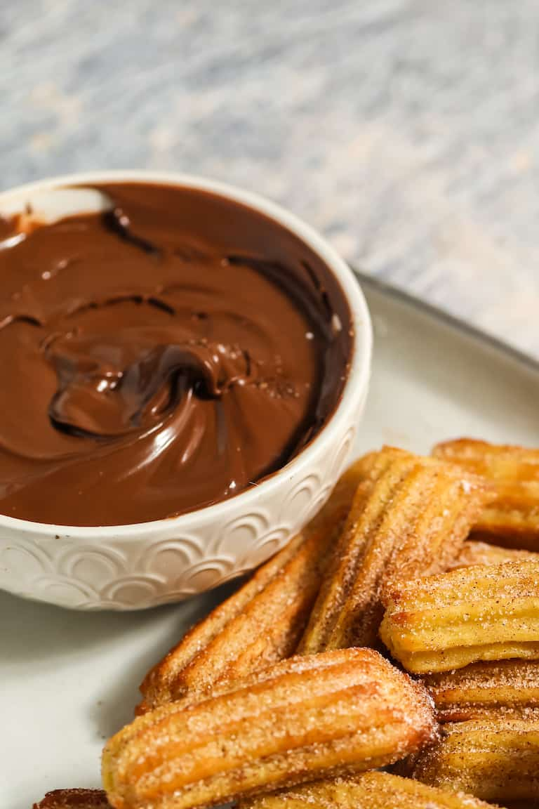 air fryer churros served with chocolate sauce