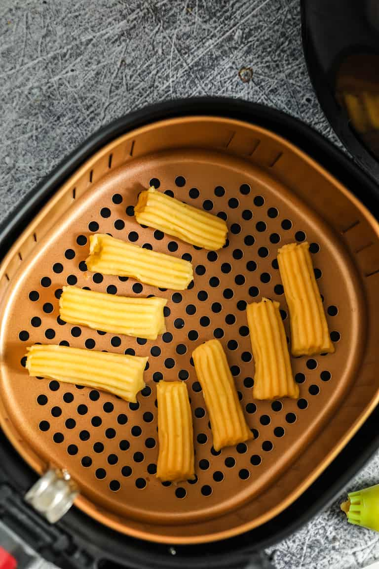 top down view of churros inside the air fryer basket