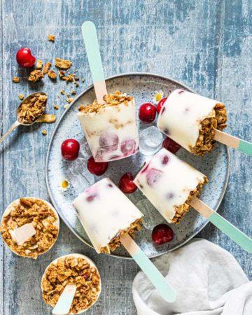 cherry yogurt popsicles served on a plate