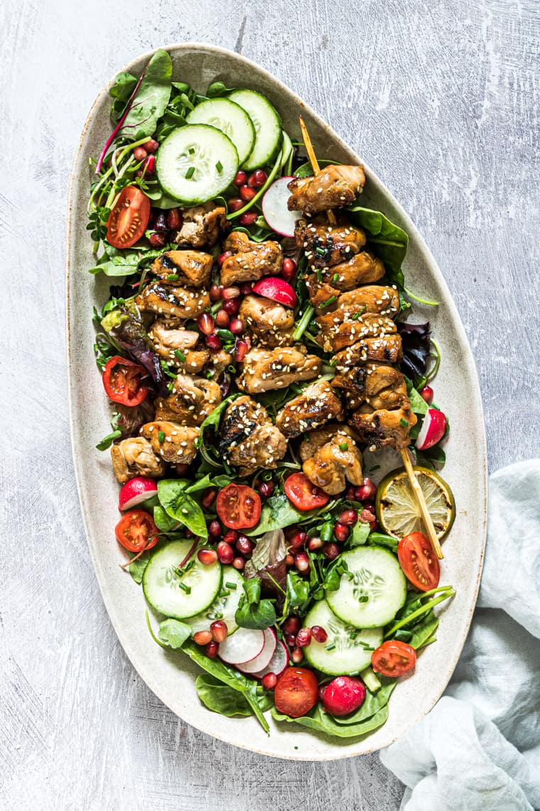 the completed grilled chicken salad recipe on a white platter