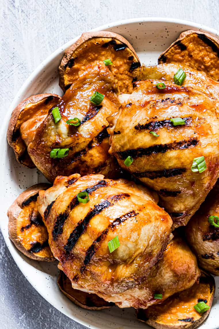 close up view of grilled chicken thighs with honey barbecue sauce