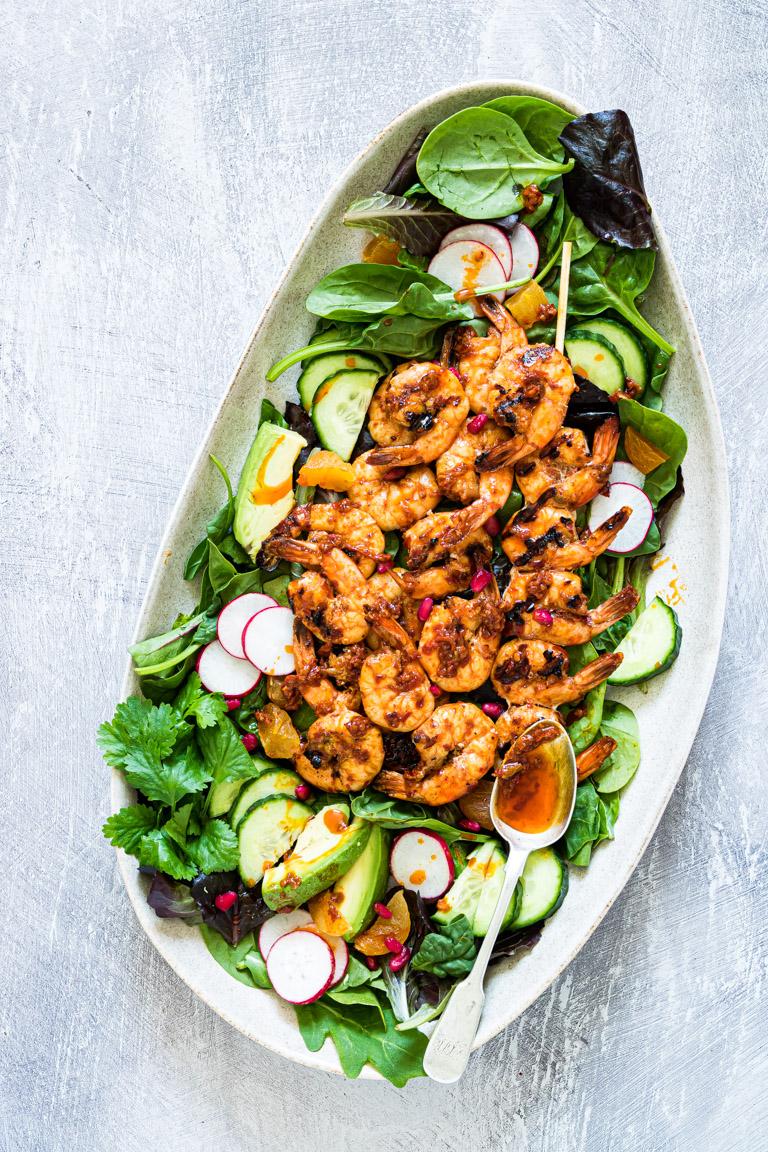 grilled shrimp salad served on a white platter