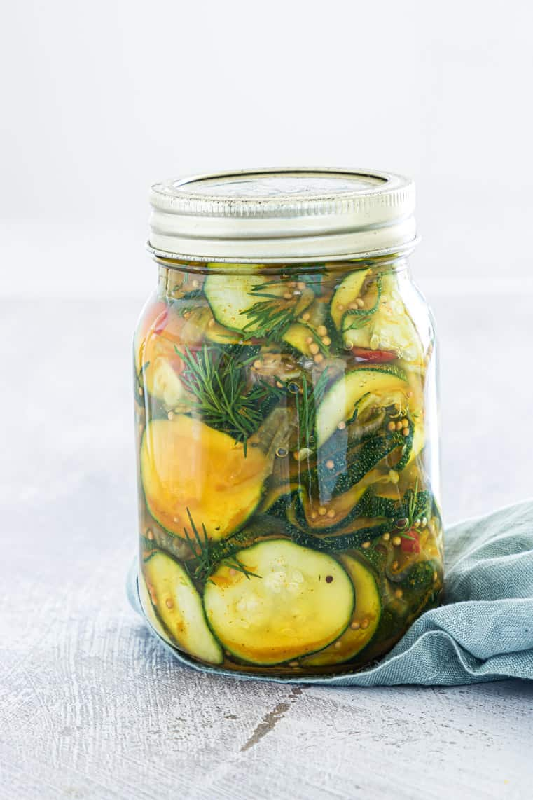 a jar of pickled zucchini with the lid on