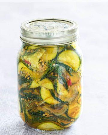 pickled zucchini in a glass mason jar