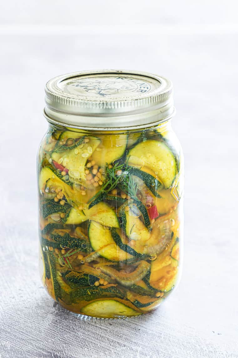 pickled zucchini in a glass mason jar