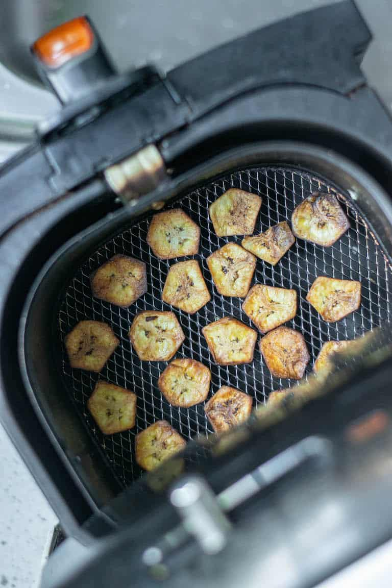 plantain chips inside the air fryer basket