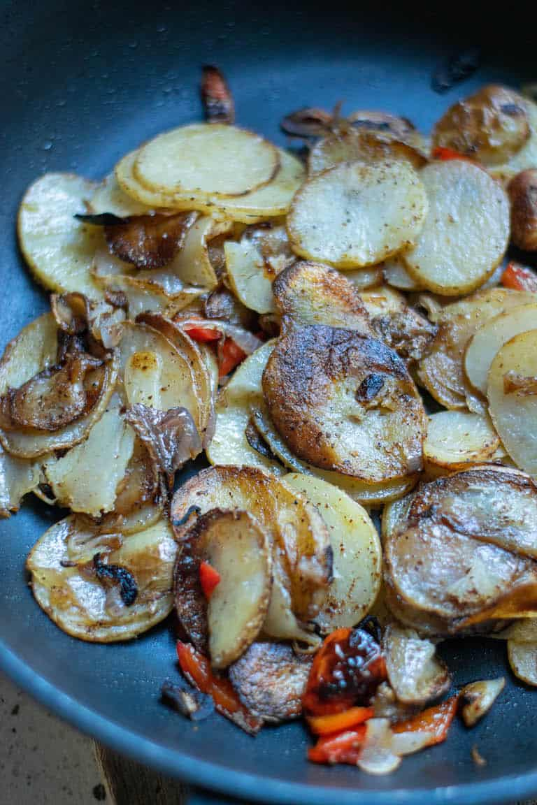 the completed smothered potatoes recipe in a skillet