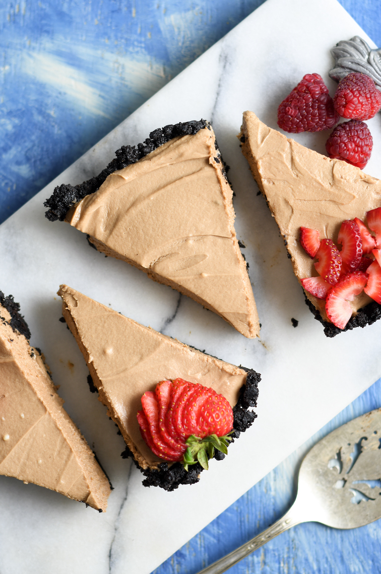 finished no bake cheesecake garnished with strawberry slices