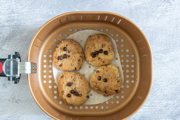 top down view of 4 air fryer cookies inside the air fryer basket