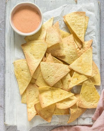 the finished air fryer tortilla chips served with dipping sauce