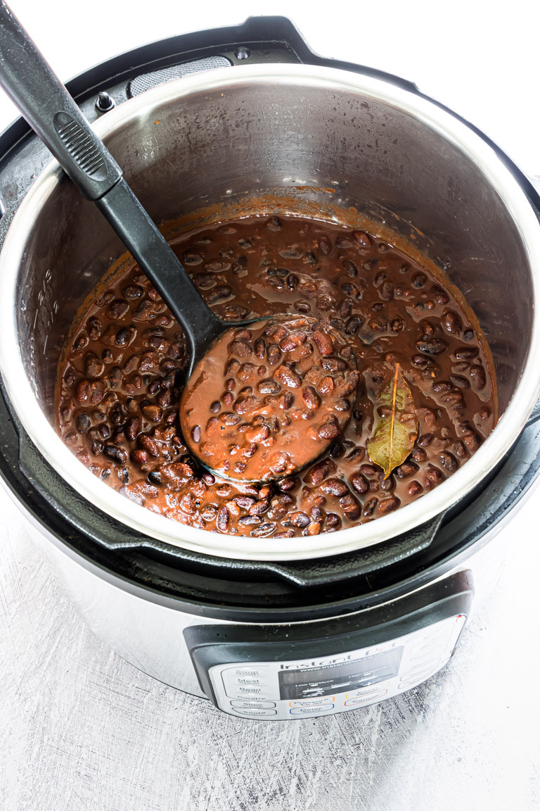 the finished instant pot black beans stew inside the instant pot