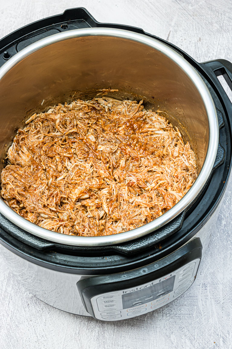 Close up picture of instant pot pulled chicken in the instant pot