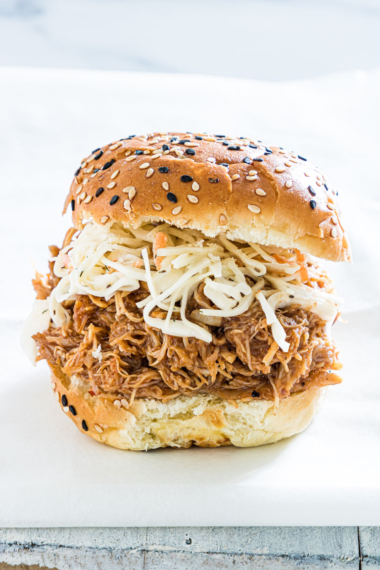close up view of a finished instant pot pulled chicken sandwich