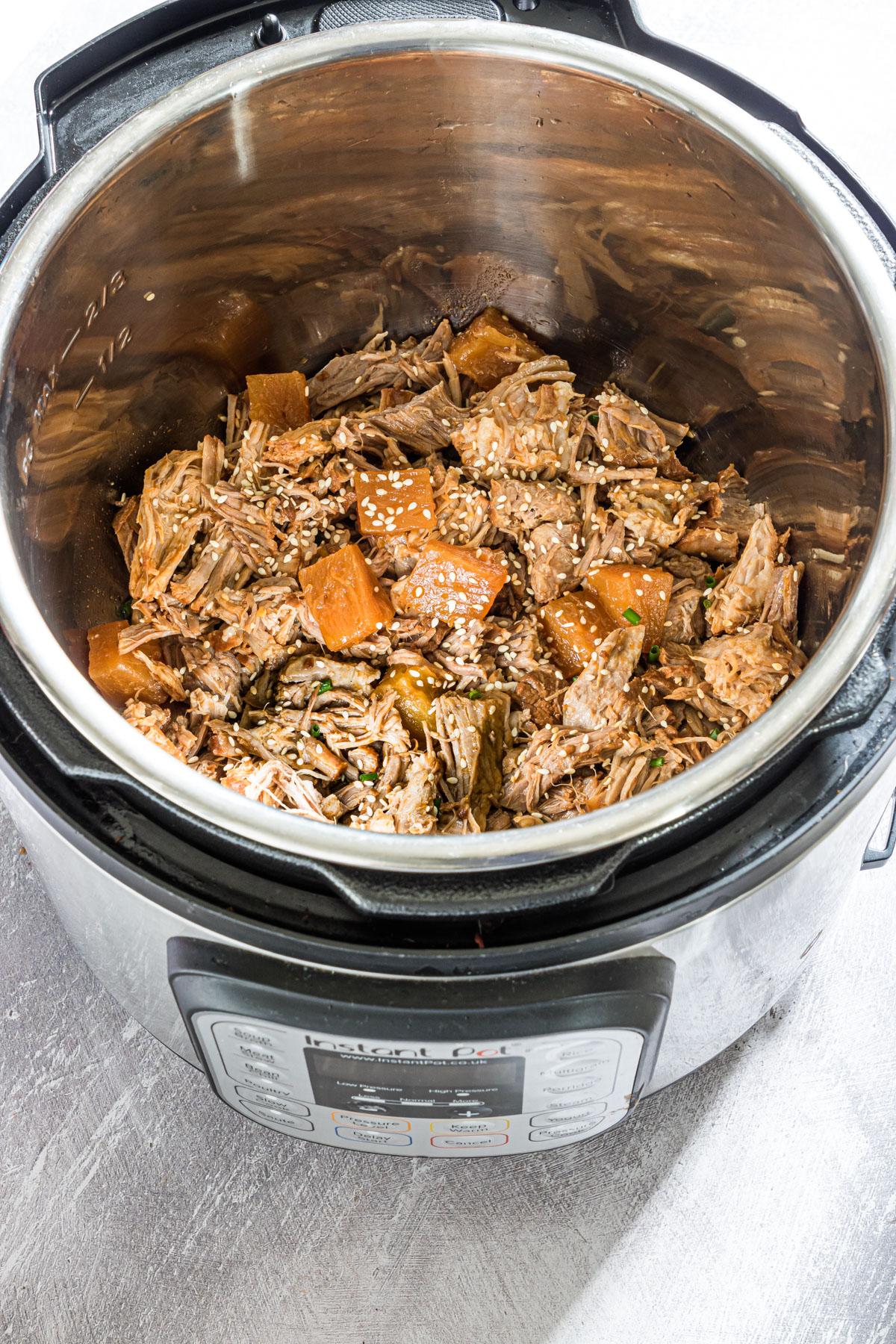 instant pot pulled pork inside the instant pot