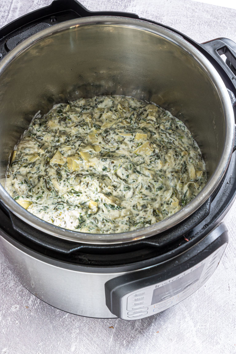 completed instant pot spinach artichoke dip inside the instant pot