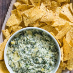 the finished instant pot spinach artichoke dip served with tortilla chips