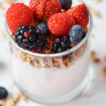 instant pot yogurt served in a glass and topped with berries and granola