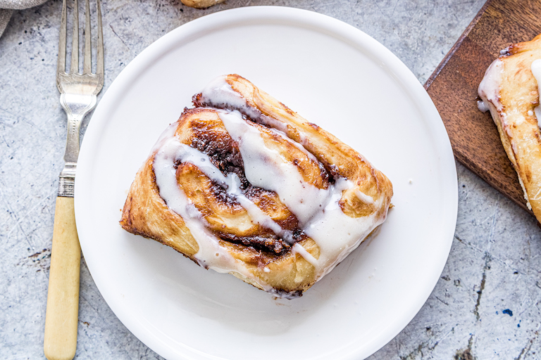 one nutella pumpkin cinnamon roll served on a white plate