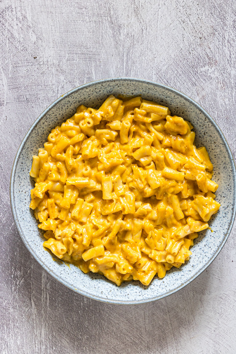 top down view of a bowl filled with instant pot pumpkin mac and cheese