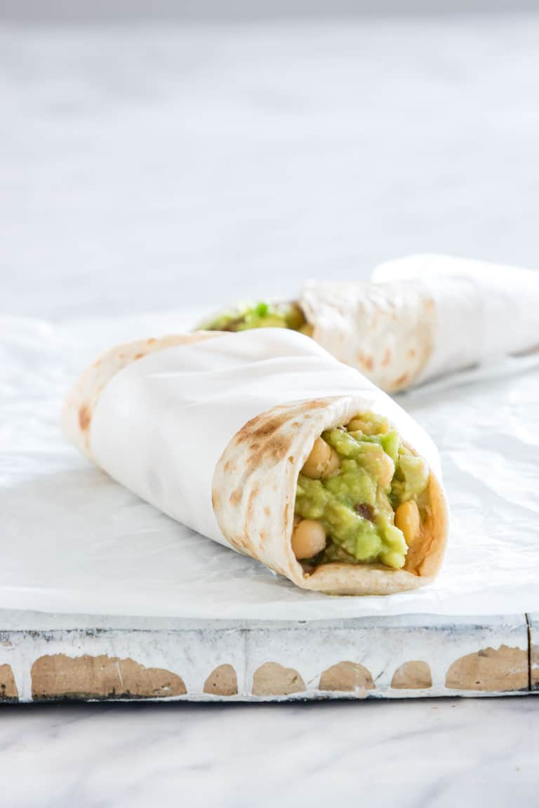 avocado wraps on a board wrapped in paper