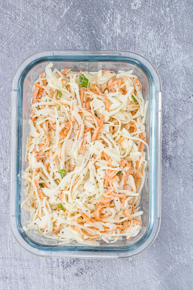 the finished southern coleslaw recipe inside glass meal prep container