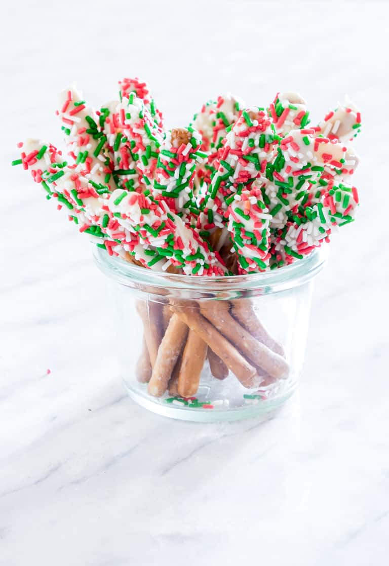 chocolate covered pretzel rods in a jar