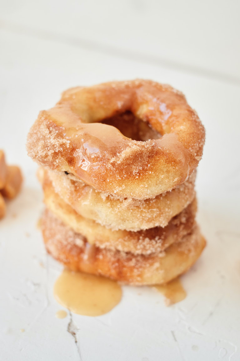 a stack of caramel apple donuts topped with caramel
